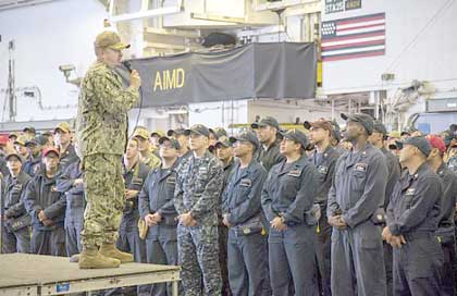 SAN DIEGO (June 29, 2018) Capt. Larry McCullen, commanding officer of the amphibious assault ship USS Bonhomme Richard (LHD 6), speaks to Sailors and Marines during an all-hands call in the ship's hangar bay. Bonhomme Richard is currently in its homeport of San Diego, Calif., preparing for an upcoming scheduled deployment. U.S. Navy photo by MC2 Jeanette Mullinax.