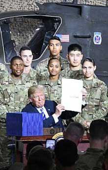 FORT DRUM, N.Y. (Aug. 13, 2018) President Donald J. Trump signs the $717 billion Fiscal 2019 National Defense Authorization Act at a ceremony. The act authorizes $24.1 billion for shipbuilding to fully fund 13 new battle force ships and accelerate funding for several future ships. This includes three Arleigh Burke-class destroyers and two Virginia-class submarines. There is also $1.6 billion for three littoral combat ships. U.S. Army photo by Michael Strasse