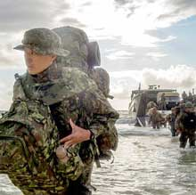 MARINE CORPS TRAINING AREA BELLOWS, Hawaii (July 28, 2018) Service members from the Japan Ground Self-Defense Force, His Majesty's Armed Forces (Tonga) and U.S. Marines disembark an Australian army Landing Craft Mechanized (LCM-8) during a multinational amphibious assault raid during the Rim of the Pacific (RIMPAC) exercise, July 28, 2018. Twenty-five nations, 46 ships, five submarines, and about 200 aircraft and 25,000 personnel are participating in RIMPAC from June 27 to Aug. 2 in and around the Hawaiian Islands and Southern California. The world's largest international maritime exercise, RIMPAC provides a unique training opportunity while fostering and sustaining cooperative relationships among participants critical to ensuring the safety of sea lanes and security of the world's oceans. RIMPAC 2018 is the 26th exercise in the series that began in 1971. (U.S. Navy photo by Mass Communication Specialist 2nd Class Kelsey J. Hockenberger
